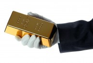 Hand Holding Gold Bullion