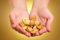 Hand Holding Scrap Gold