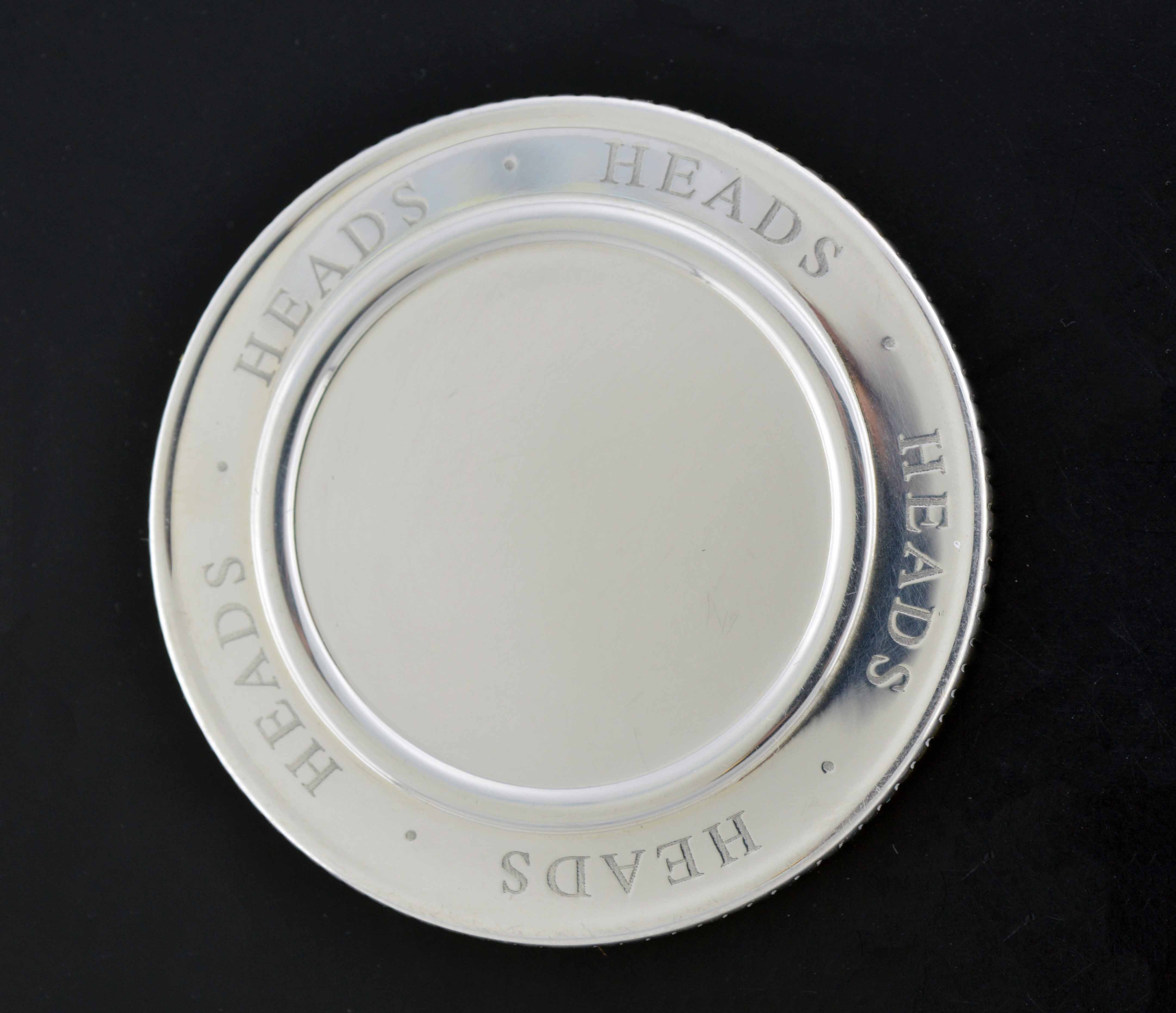 tiffany heads tails coin